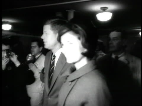 stockvideo's en b-roll-footage met us senator john f kennedy and wife jacqueline walk toward a voting booth as photographers follow them - jacqueline kennedy