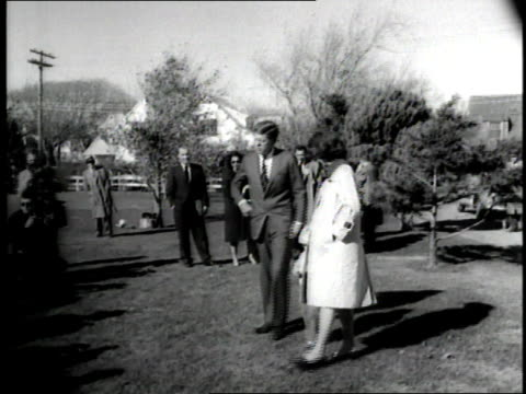 stockvideo's en b-roll-footage met us senator john f kennedy wife jacqueline and daughter caroline walk together on the grass near journalists and photographers - jacqueline kennedy