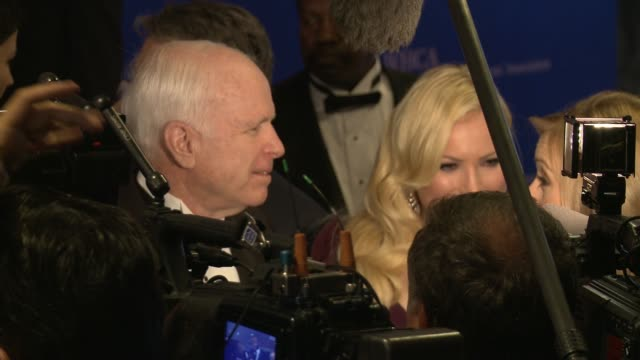 senator john mccain and his daughter meghan do interviews on the red carpet at the washington hilton. in the 2nd shot, the vinkelvoss twins are... - john mccain stock videos & royalty-free footage