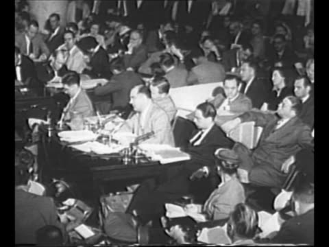 us senator joseph mccarthy sits at senate subcommittee on investigations hearing on the us army flanked by investigator francis carr and attorney roy... - 法廷審問点の映像素材/bロール