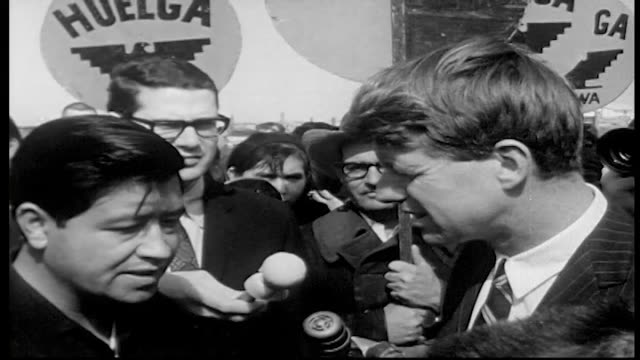 senator kennedy talks with cesar chavez talks to strikers sits on panel in crowded auditorium - farm worker stock videos & royalty-free footage
