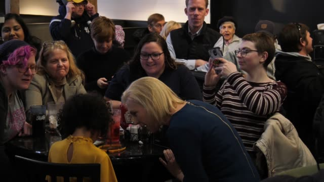 US Senator Kirsten Gillibrand meets Iowa voters and shakes hands in Cedar Rapids Ia before a campaign rally at a bar