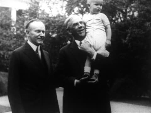 senator reed smoot holding child star baby snookums as calivin coolidge looks on / newsreel - 1927 stock videos & royalty-free footage