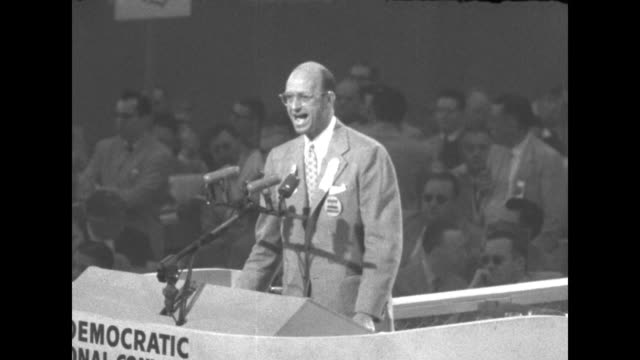 senator richard russell standing on rostrum speaking / delegates listening / russell after finishing speech leaves rostrum / reporters sitting at... - sam rayburn video stock e b–roll