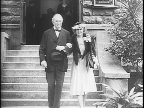 Senator Tom Connally and his second wife Lucile Sheppard exiting a church on their wedding day Connally shaking hands with the minister / bride and...