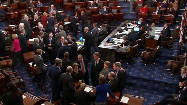 senators are seen deliberating in separate clusters on the floor in a failed attempt to avoid a partial government shutdown - senate stock videos & royalty-free footage