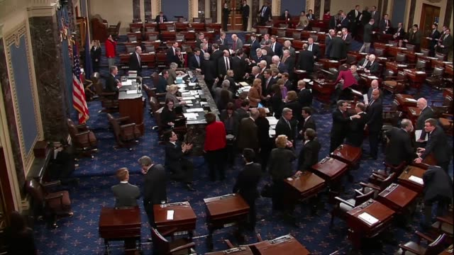 senators are seen in the chamber during a latenight vote on a sixmonth spending bill introduced the night before - united states senate stock videos & royalty-free footage