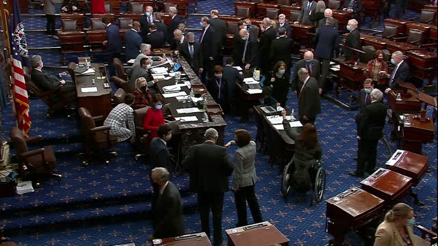 vídeos de stock e filmes b-roll de senators are seen on the floor in an exotic new year's day session during a roll call vote on whether to override a veto issued by president donald... - senado dos estados unidos