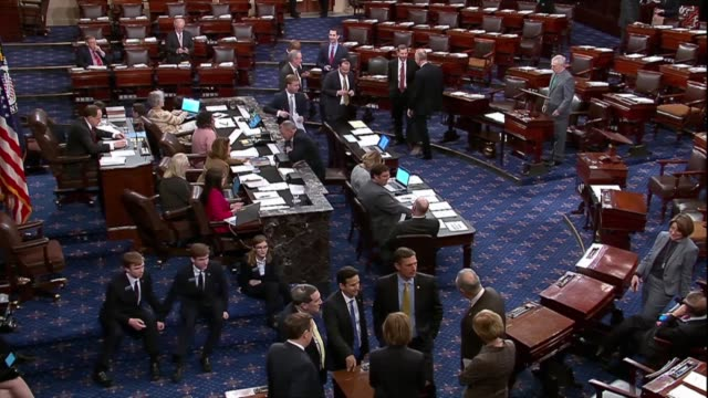 senators confer with one another in groups on the senate floor during a vote to proceed to a war powers resolution regarding saudi arabia and yemen. - senate stock videos & royalty-free footage