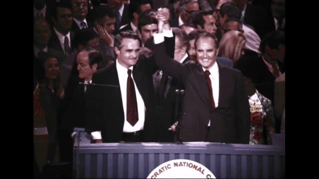 stockvideo's en b-roll-footage met senators george mcgovern of south dakota and running mate senator thomas eagleton of missouri acknowledge the cheers of the delegates at the... - 1972