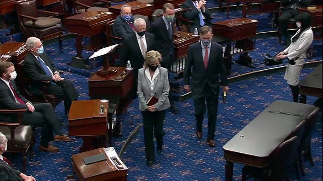 senators walk down center aisle of the senate chamber, vice president mike pence administering the oath of office before each sign the official oath... - senate stock videos & royalty-free footage
