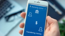 Sending money on banking app on the smartphone
