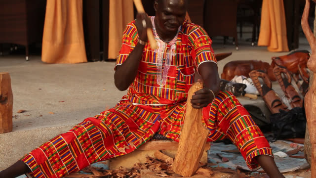 senegalese craftsman carves wooden ormnament - sculpture stock videos & royalty-free footage