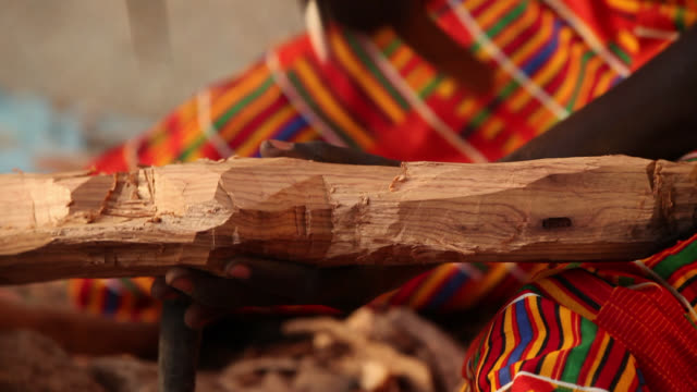 senegalese craftsman carves wooden ormnament - hobbies stock videos & royalty-free footage