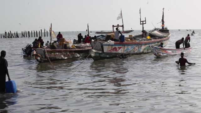 senegalese fishermen in mbour  - senegal stock videos & royalty-free footage