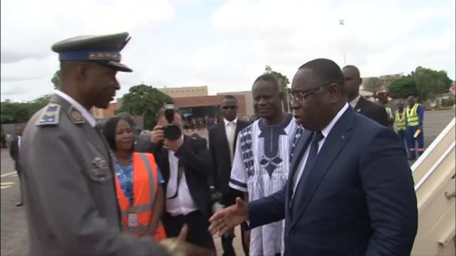 senegalese president macky sall chairman of the economic community of west african states ecowas and benin president thomas boni yayi arrive in... - benin stock videos and b-roll footage