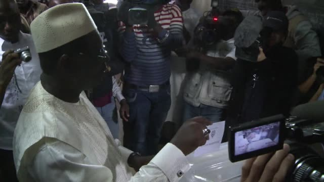 senegalese voted on sunday in a run-off election in which the 85-year-old incumbent abdoulaye wade is fighting off a mass opposition effort to foil... - runoff election stock videos & royalty-free footage