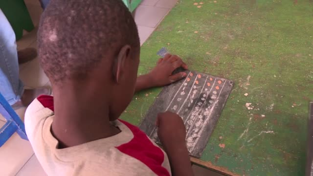 vídeos de stock, filmes e b-roll de senegal's estimated 50000 child beggars are out in force every day of the week in dakar despite a government crackdown on the practice a year ago - senegal