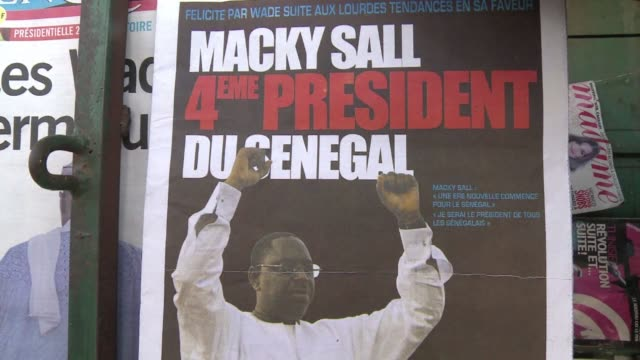 vídeos de stock e filmes b-roll de senegal's media on monday hailed macky sall's victory in the presidential election and incumbent abdoulaye wade's acceptance of defeat as a victory... - senegal