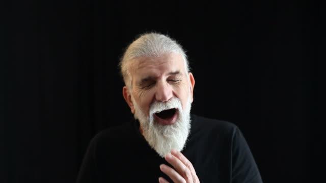Senior actor practicing facial expression of terrified man