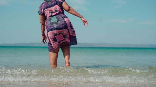 senior adault walking on the beach