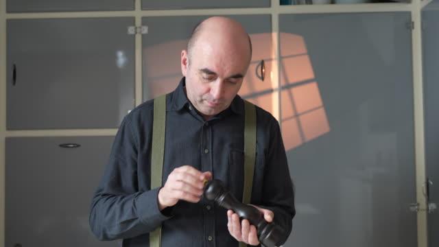 senior adult adjusting pepper mill - suspenders stock videos & royalty-free footage