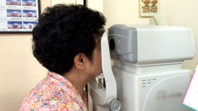 senior adult check in her eyes - ophthalmologist stock videos and b-roll footage