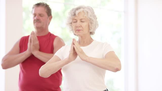 Senior Adult Couple Meditating