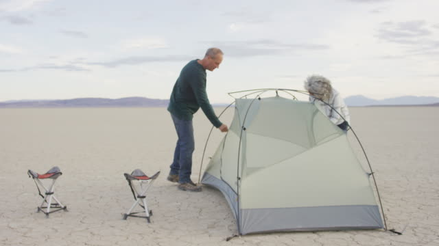 senior adult couple setting up their tent in the desert - pacific islander couple stock videos & royalty-free footage