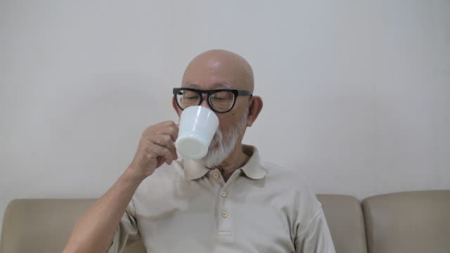 senior adult drinking coffee at home - coffee drink stock videos & royalty-free footage
