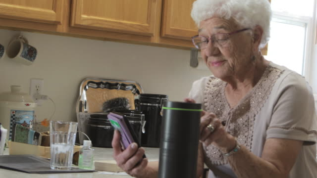 senior adult female in domestic residence kitchen 4k video - home ownership stock videos & royalty-free footage