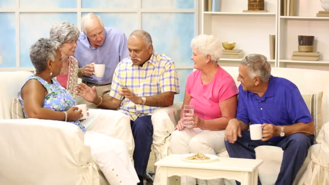 senior adult friends share news, friendship.  home or assisted living. - sheltered housing stock videos & royalty-free footage