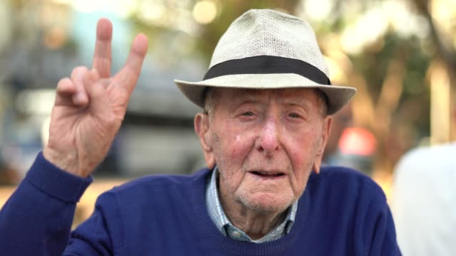 Senior adult male gesturing hand; he is 91 years old