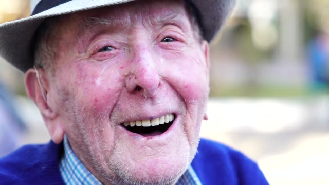 Senior adult male laughing portrait; he is 91 years old