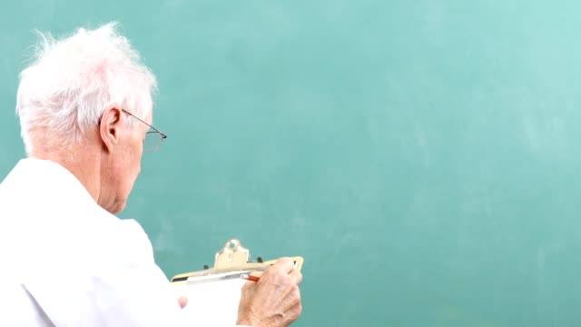 senior adult man scientist, mathematician wearing lab coat with chalkboard. - mathematician stock videos & royalty-free footage