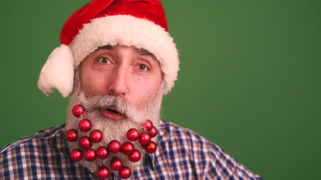 senior adult man with a beard in elegant hat of santa claus looking into the camera and have fun singing shaking his head - plaid shirt stock videos & royalty-free footage