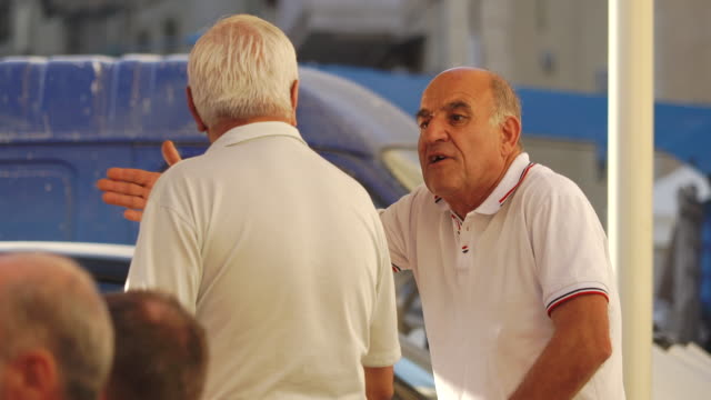 senior adult men have conversation - Malta
