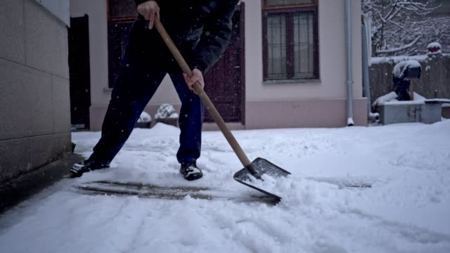 senior adult shoveling snow in his yard - digging stock videos & royalty-free footage