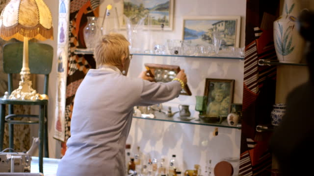 Senior adult woman browsing in antiques store