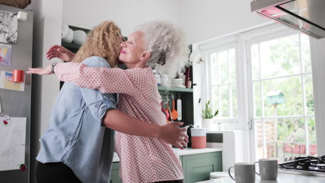 senior adult woman hugging daughter - embracing stock videos & royalty-free footage
