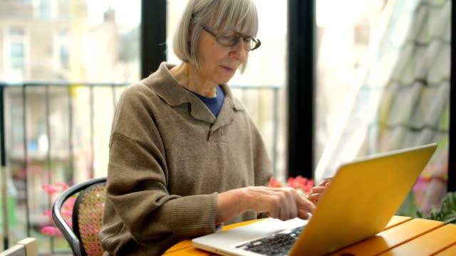 Senior adult woman shopping on internet