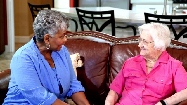 Senior adult women friends in assisted living community.