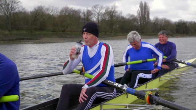 senior adults rowing - quattro con video stock e b–roll