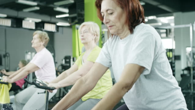 senior adults taking exercise class - adult stock videos & royalty-free footage