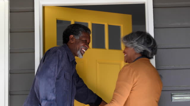 senior african american couple arriving home, opening front door - 60 69 years stock videos & royalty-free footage