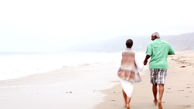 Senior African American couple on sandy beach