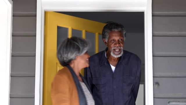 senior african american couple opening door and leaving house - leaving stock videos & royalty-free footage