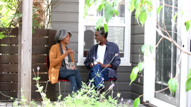 senior african american couple outside house, talking - santa monica house stock videos & royalty-free footage