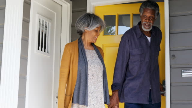Senior African American Family At The House Front Door