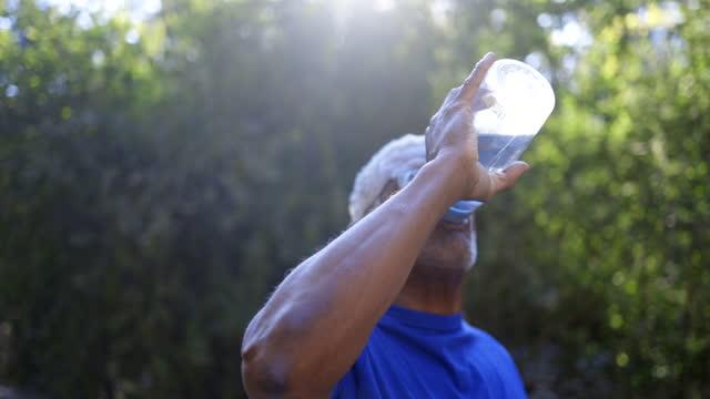 senior african american man drinking water - thirsty stock videos & royalty-free footage